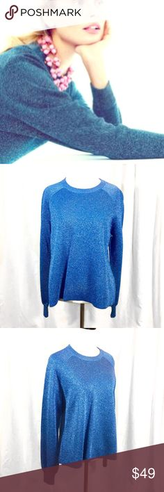 """J. Crew // Sparkle Side-Slit Sweater Metallic Blue New without tags! Get your sparkle on! Let your layering skills shine with deep side slits that allow you to show off a tank, button down, or tee. Metallic yarn on the outside and soft, cozy cotton on the inside. Loose fit. Hits at hip. No imperfections. Approx 22"""" front length, 24"""" back length, 20"""" across chest🚫trades🚫 smoke free home. J. Crew Sweaters Crew & Scoop Necks"""