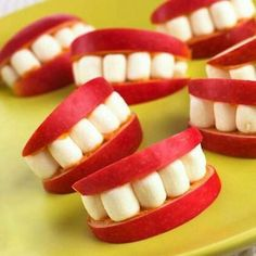 Apple smiles-- apple slices, mini marshmallows, & soy butter to hold everything together-- totally going to do these this Halloween.