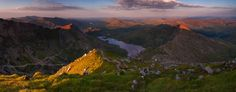 Panorama of Crib Goch Carnedd Ungain Snowdon Lliwedd Snowdonia North Wales at Summer sunset light. Sunset over Crib Goch Carnedd Ungain Snowdon Lliwedd Panoramic canvas prints for sale. Canvas prints for sale of the best view in UK from the Snowdon summit Snowdonia North Wales UK.