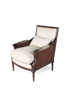 The Malta Bergère is shown in Oak with a Classic finish. Note the caned sides, the fluted en carquois legs and the elegance of its rectangular à la reine back.