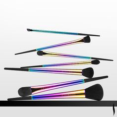 Displayed on a black acrylic stand, this set of metallic, rainbow-finish face and eye brushes are as beautiful to look at as the looks they create. #SEPHORA COLLECTION Holiday Light Show Brush Set #BrushingUp