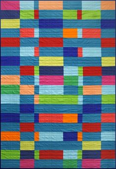I really love the solid colors and how they move around on this quilt.