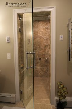 Master bathroom remodel by Renovisions. Tile shower, bench seat, safety grab bars, walk-in shower, lineal drain, glass shower door...