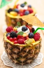 FRUIT SALAD...1 pineapple cut in half, across   juice from 1 lemon   1/2 cup of seedless grapes   1 can of mandarin, drained  1 sliced banana  6 sliced strawberries  2 sliced kiwi  1/2 cup raspberries  1/2 cup blueberries  1/2 cup pineapple chunks        dressing mixture    Juice from a lime  1/2 cup of pineapple juice  1 tsp ground ginger