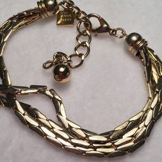 Rare Vintage Ann Klein Heavy Gold toned Bracelet Rare Vintage Ann Klein Heavy Gold toned Bracelet. Heavy 3 strand bracelet. The movement and lighting changes the color and appearance. Has a Ann Klein charm with her name and a lion on it. The claw clasp is strong. This bracelet can be adjusted for size. Condition: Vintage. Thank You for visiting BlackBeards where all Treasures are Pre owned/used, examined, & researched (5>=90 hrs). We search the USA for Lost Rare Irreplaceable Treasures. Age…