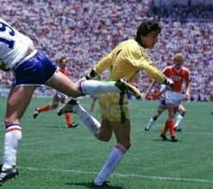 France 1 USSR 1 in 1986 in Leon. Rinat Dasayev punches clear with Yannick Stopyra diving in at the World Cup Finals in Group C.