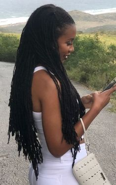 For your next new protective hairstyle, we're telling you how to do faux locs and showing our fave long and short faux locs styles using Marley hair and more. Updo Styles, Curly Hair Styles, Natural Hair Styles, Locs Styles, Megan Good, Goddess Locs, Lisa Bonet, Nattes Twist Outs, Curly Faux Locs