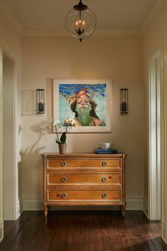 hallway with artwork by Samantha French