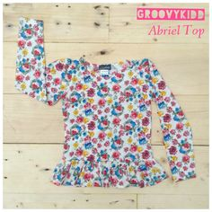 Abriel Top PRODUCT TYPE : T-shirt COLOR MATERIAL : Cotton  PRICE : 100k Available size : 1 years : 2 years :  3 years :  4 years :  5 years :  7 years :  10 years: For further information , you can contact us through SMS : 081320942222 line ID : groovykidd bbm : 21e1af8b Phone :022-87788662 Please put your data as below -NAME -ADDRESS -PHONE NUMBER -E-MAIL -ORDER   WE WILL NOT REPLY COMMENT ON PICTURE Seluruh pertanyaan mengenai detail produk, harap hubungi admin kami.terima kasih