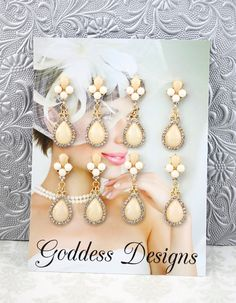 """Bridal Earrings Set of Four Bridesmaid by goddessdesignsgems, $80.00 *This listing is for a """"Set of Four"""" pairs of earrings* """"Truly elegant"""" these unique earrings feature a """"gorgeous"""" design with a brilliantly clear Austrian crystals with a pear shaped drop in a two tone color of ivory and white. Earrings are gold plated post style and measure approx 2 """" in length."""