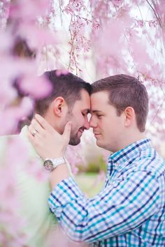 We're swooning over this dreamy photo of grooms-to-be Justin and Nathan by Casey Hendrickson Photography. They're so completely caught up in their love for each other that nothing else matters, as if the world has stopped just for them. See more of their outdoor engagement photography session amidst the cherry trees in Washington, D.C. on Equally Wed: http://eqwd.co/1Ox3iSK