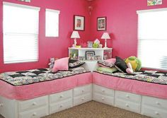 girls' bedroom in hot pink with black and white toile accents - drawers under built-in platform bed frames