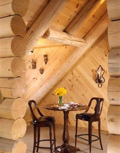 Small table for tea or a game of cards in a cozy corner of a log home