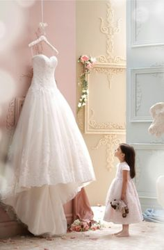 The perfect picture ❤ brides dress and the flower girl