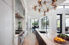 Oak island. Lacquer white cabinets. Arizona Organic | Kitchen Gallery | Sub-Zero & Wolf Appliances