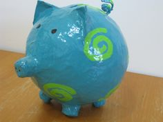 2012 - Teal paper mache piggy bank with Lime Green swirls