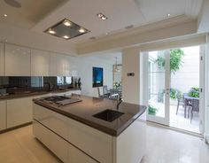 The four-bedroom property in central London's Farm Street has all the trappings of modern luxury with an indoor swimming pool, gym, lift, cinema room and roof terrace. Kitchen Countertops, Kitchen Cabinets, Brown Kitchens, Parlour, Kitchenette, Modern Luxury, Home Buying, Property For Sale, Toilet