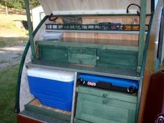Here's the 2phun teardrop's back hatch. Simple, functional kitchen using camp stove and cooler. Cheap, easy, smart.