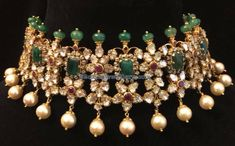 Diamonds and emeralds pachi work choker with green round emerald beads embellished at the top from Pushkala Jewellers