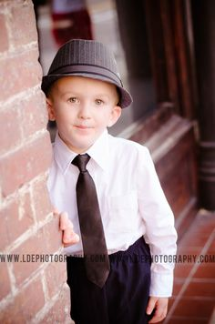 PORTRAIT LDE photography in Riverview,Florida  Subject: boy age 4 Location: Ybor Tampa Florida Pose: standing leaning Time: evening  Photo Session Christmas family