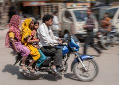 This happens only in India. 4 people on one bike. :)