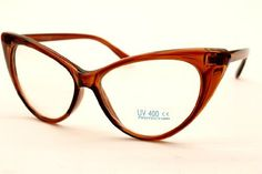 """Vintage Cat Eye Clear Sunglasses Eyeglasses Womens Brown E16 Style Vault. $10.95. Blocks harmful UVB & UVA, meets ANSI Z80.3. plastic frame. plastic lens. Size: Width x Height  15CM X 5.5CM ,  5  7/8"""" X 2"""". non-polarized. Lens width: - . Stylish and comfortable for everyday wear. Optical quality"""