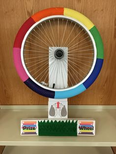 """DIY """"Spin the Wheel"""" rainbow. We use this at the library and kids can spin to win a prize."""