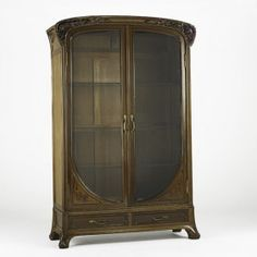 LOUIS MAJORELLE; Large armoire with carved and inlaid poppies, France, ca. 1905; Mahogany, walnut, gilt bronze, glass and marquetry