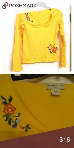 Banana Republic yellow embroidered long sleeve tee 100% cotton long sleeve yellow tshirt.  Unfinished hem around the collar with gather at the bust and a double hem at the waist. Beautiful machine embroidered flowers.  In excellent used condition.  I'm open to offers and love to discount on bundles. Banana Republic Tops Tees - Long Sleeve