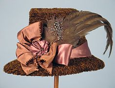 Chenille Sporting Hat, 1870s. Hats grew in width and height throughout the period and became more and more elaborate including ostrich feather, stuffed birds and more. This particular hat was called an inverted flower pot hat.