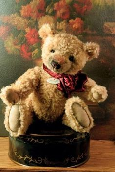 "wadsworth teddy bear.                Wadsworth Teddy Bear       This waif has a nose rubbed bare...presumably from countless kisses. Vintage ribbon with porcelain name tag, growler, hand sewn, limited edition. Jointed. 13"" sitting, 18"" tall. $49.95"