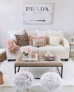 neutral living room ideas with fuzzy stools and lots of pillows.