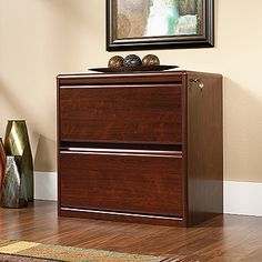 Anti-cascading file drawers hold letter, legal or European size hanging files.   Full extension slides.  Key lock.  Classic Cherry finish.