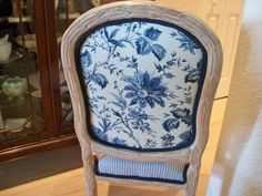 blue and white floral fabric on back of chair