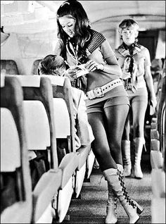 1970's Stewardess. LOVE the go go boots and hot pants!