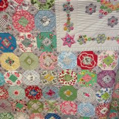 Emma Mary Quilt by Judy Newman: Hexagon Medallion quilts surrounded by yummy floral donut blocks
