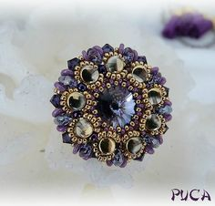 Pella purple - Materials: 14 mm rivoli, 11/0 delica, 15/0 rocails in 2 colors, 6/0-os or 8/0-as rocails (should been checked), pellet beads, 9 pieces 4 mm Swarovski bicone, Superduo, O-bead