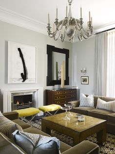 layout with two sofas, stools, chest of drawers and large mirror Bruce Norman Long