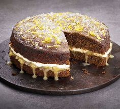 Sticky ginger lemon drizzle cake - Adapt one of our highest-rated cakes with tangy ginger, cream cheese frosting and citrus curd Bbc Good Food Recipes, Sweet Recipes, Baking Recipes, Cake Recipes, Citrus Recipes, Kitchen Recipes, Dessert Recipes, Limoncello, Lemon Drizzle Icing