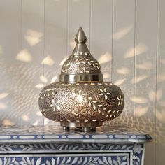 Moroccan style lanterns like this one from Grahame and Green - Casablanca Tyre Lamp give a Bohemian glow and create patterns on the wall