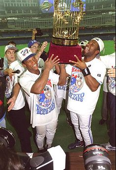 Rickey Henderson and Joe Carter of the Toronto Blue Jays hoist the World Series trophy after defeating the Philadelphia Phillies 86 on Carter's Blue Jays World Series, Baseball Toronto, Rickey Henderson, Winners And Losers, Baseball League, Baseball Pictures, Mlb Teams, Sports Wallpapers, Toronto Blue Jays