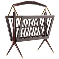 Foldable Magazine Stand, Rosewood with Copper Elements, Gio Ponti Style | From a unique collection of antique and modern magazine racks and stands at https://www.1stdibs.com/furniture/more-furniture-collectibles/magazine-racks-stands/