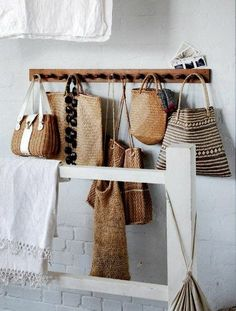 straw bags on pegboard displayed at i gigi general store - as seen on linenandlavender.net - http://www.linenandlavender.net/2014/01/source-sharing-i-gigi-general-store-uk.html