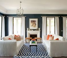 chevron rug, sofa arrangement, bright pillows.