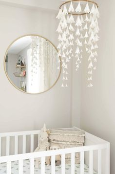 A large mirror will instantly liven up a monochromatic room.