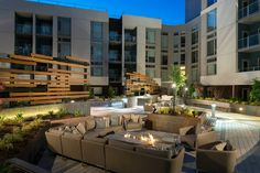 Outdoor Lounge with screen wall and fire pit at Channel Mission Bay Apartments in San Francisco, CA