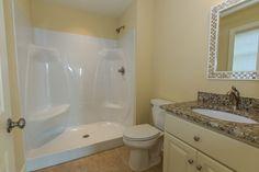 Beach Home #152 with Venetian Gold Granite and Maax Acrylic Shower Insert