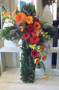 Sympathy Flowers | an impressive standing spray with gladiolas in three colors carnations ...