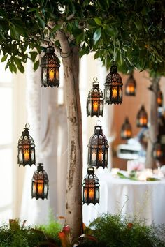 Absolutely love this old world-style lanterns hanging from a tree. It's small details like this that can go a long way. Fill your lanterns with Candle Impressions Flameless Candles so you don't need to worry about them blowing out in the wind