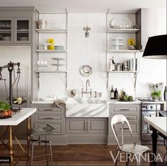 Grey Kitchen - grey kitchen cabinets, marble countertop and sink, open kitchen shelving